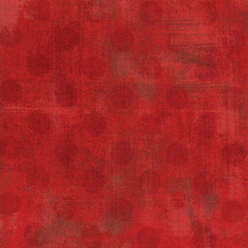 Donkerrode stippen op rode ondergrond. Quiltstof, katoen