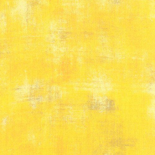 Het meest zonnige en intense geel in het Grungespectrum. Opvallend en levendig, met lichte en beige vlekken en oranje vegen. Quiltstof, 100% katoen