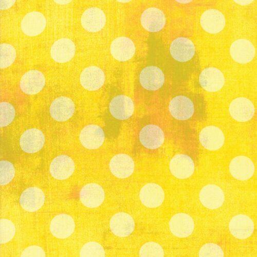 Stralend gele quiltstof met donkere vlekken en lichte stippen. Quiltstof, 100% katoen