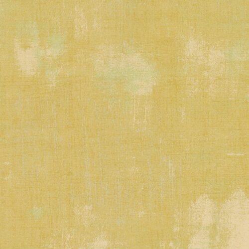 Gele quiltstof, met mintgroene vegen. 100% katoen