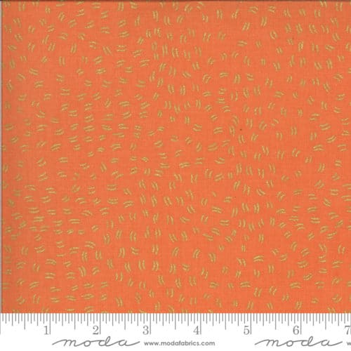 Oranje moderne quiltstof met goudgele stippen, metallics